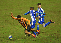 Hull City's Mallik Wilks is fouled by  Wigan Athletic's Tendayi Darikwa<br /> <br /> Photographer Dave Howarth/CameraSport<br /> <br /> The EFL Sky Bet League One - Wigan Athletic v Hull City - Wednesday 17th February 2021 - DW Stadium - Wigan<br /> <br /> World Copyright © 2021 CameraSport. All rights reserved. 43 Linden Ave. Countesthorpe. Leicester. England. LE8 5PG - Tel: +44 (0) 116 277 4147 - admin@camerasport.com - www.camerasport.com