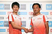 Shogo Nakamura (left) poses with coach Tadashi Fukushima after winning the men's race in 2:11:28 during the Marathon Grand Championship, Sunday Sept. 15 2019, in Tokyo. (Agence SHOT/Image of Sport via AP)