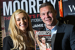 """© Licensed to London News Pictures . 09/07/2016 . Manchester , UK . Boxer JAMIE MOORE (r) with actress CATHERINE TYLDESLEY at a signing for Jamie's book """" Mooresy """" at Waterstones on Deansgate in Manchester City Centre . Photo credit : Joel Goodman/LNP"""