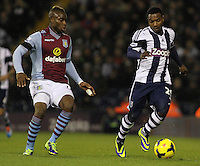 West Bromwich Albion's Stephane Sessegnon and Aston Villa's Yacouba Sylla in action during todays match.<br /> <br /> Photo by James Marsh/CameraSport<br /> <br /> Football - Barclays Premiership - West Bromwich Albion v Aston Villa - Monday 25th November 2013 - The Hawthorns - West Bromwich<br /> <br /> © CameraSport - 43 Linden Ave. Countesthorpe. Leicester. England. LE8 5PG - Tel: +44 (0) 116 277 4147 - admin@camerasport.com - www.camerasport.com