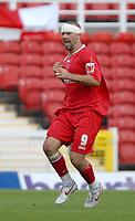 Photo: Ed Godden.<br />Swindon Town v Stockport County. Coca Cola League 2. 26/08/2006. Christian Roberts celebrates his goal for Swindon.