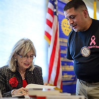 102214       Cayla Nimmo<br /> <br /> Senator Dede Feldman signs a copy of her book for Rotary Club member Jason Sanchez after her speech to the Ratoray Club of Gallup held in Sammy C's in downtown Gallup Wednesday afternoon.