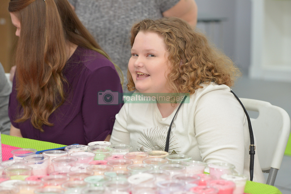 """EXCLUSIVE: June Shannon (Mama June) and her daughters, Alana Thompson (Honey Boo Boo) and Lauryn Shannon (Pumpkin) and her boyfriend, Josh Efird, their 2 month old daughter, Ella Grace Efird, sister JoAnne Shannon (Doe Doe), and niece Amber Busby and other family members raise money for the Children's Hospital of Macon in Hampton, Ga. on February 18, 2018. They had a fan meet and greet at Last Chance Liquidators, Doe Doe's store. They sold raffle tickets for mystery boxes of products, homemade slime, and signed posters of their new television show on the WE network, """"Mama June, From Not to Hot"""". Alana stayed up to 5 a.m to make 450 jars of slime. They are donating half the proceeds and garnering more support on social media for the cause. 18 Feb 2018 Pictured: June Shannon (Mama June) and her daughters, Alana Thompson (Honey Boo Boo) and Lauryn Shannon (Pumpkin) and her boyfriend, Josh Efird, their 2 month old daughter, Ella Grace Efird, sister JoAnne Shannon (Doe Doe), and niece Amber Busby and other family members raise money for the Children's Hospital of Macon in Hampton, Ga. on February 18, 2018. They had a fan meet and greet at Last Chance Liquidators, Doe Doe's store. They sold raffle tickets for mystery boxes of products, homemade slime, and signed posters of their new television show on the WE network, """"Mama June, From Not to Hot"""". Alana stayed up to 5 a.m to make 450 jars of slime. They are donating half the proceeds and garnering more support on social media for the cause. Photo credit: Dana Mixer / MEGA TheMegaAgency.com +1 888 505 6342"""