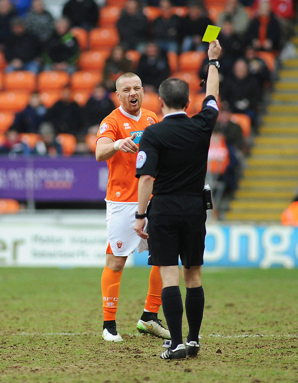 Blackpool's Jamie O'Hara can see Referee Keith Stroud's perspective as he's shown a yellow card<br /> <br /> Photographer Kevin Barnes/CameraSport<br /> <br /> Football - The Football League Sky Bet Championship - Blackpool v Wigan Athletic - Saturday 28th February 2015 - Bloomfield Road - Blackpool<br /> <br /> © CameraSport - 43 Linden Ave. Countesthorpe. Leicester. England. LE8 5PG - Tel: +44 (0) 116 277 4147 - admin@camerasport.com - www.camerasport.com