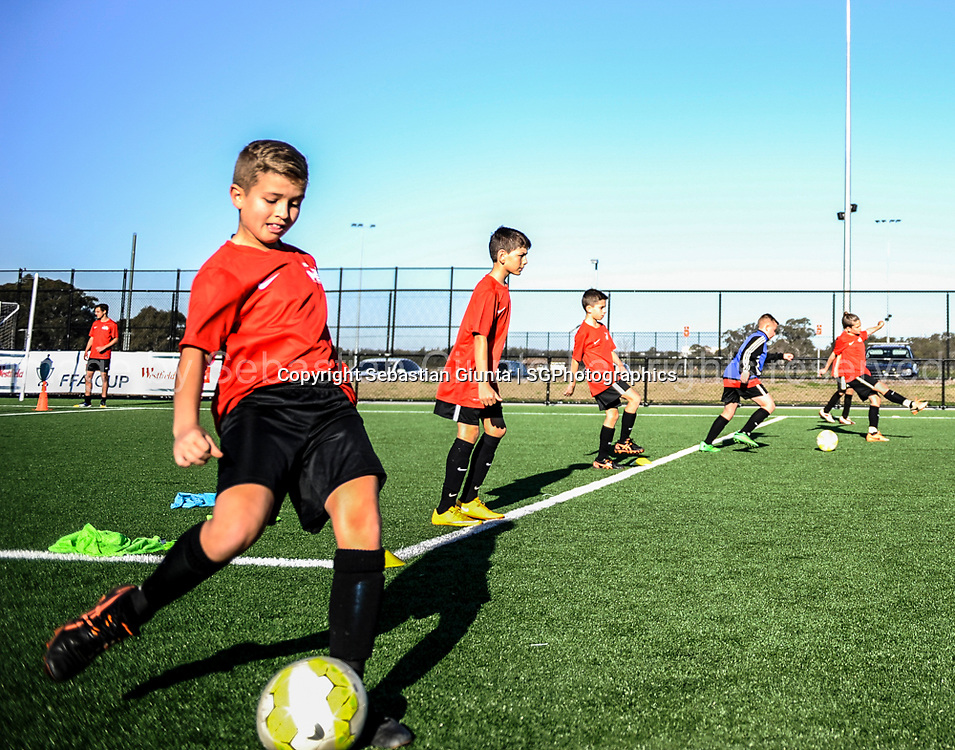 Mile Sterjovski Football Clinic carried out during the school holidays June 2015. Photo by Sebastian Giunta   sgphotographics.com