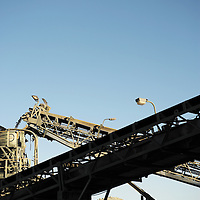 Mine worker silhouettes in plant area of a minister