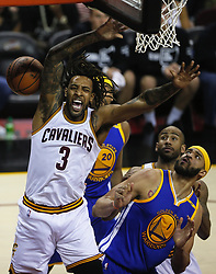 June 9, 2017 - Cleveland, OH, USA - The Cleveland Cavaliers' Derrick Williams (3) is fouled going up for a bucket against the Golden State Warriors in the fourth quarter during Game 4 of the NBA Finals at Quicken Loans Arena in Cleveland on Friday, June 9, 2017. The Cavs won, 137-116, trimming their series deficit to 3-1. (Credit Image: © Leah Klafczynski/TNS via ZUMA Wire)