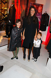 LISA MOORISH and her children MOLLY MOORISH and ASTILE DOHERTY at a party to celebrate the launch of DKNY Kids and Halloween in aid of CLIC Sargent and RX Art held at DKNY, 27 Old Bond Street, London on 31st October 2006.<br />