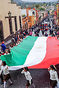 Young school girls carry a massive Mexican flag during a parade to celebrate the 251st birthday of the Mexican Independence hero Ignacio Allende January 21, 2020 in San Miguel de Allende, Guanajuato, Mexico. Allende, from a wealthy family in San Miguel played a major role in the independency war against Spain in 1810 and later honored by his home city by adding his name.