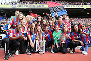 Crystal Palace FC ladies Celebrate winning the FA Premier League South East Division 1 and the Surrey Cup during half time break. Crystal Palace ladies posing with the the Surrey Cup & League Cup during half time break. Crystal Palace ladies lifting the Surrey Cup & League Cup during half time break. Barclays Premier League match, Crystal Palace v Stoke City at Selhurst Park in London on Saturday 7th May 2016. pic by John Patrick Fletcher, Andrew Orchard sports photography.