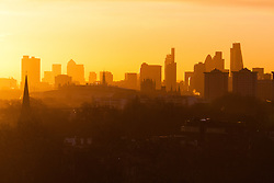 Primrose Hill, London, March 2nd 2015. As forecasters are beginning to predict the coming of spring, the sun rises over London as dog walkers and runners exercise on Primrose Hill as the sun rises on a chilly London morning.
