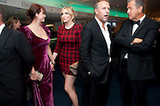 JASMINE GUINNESS; SOPHIE DAHL; SIMON MILLS; MARIO TESTINO, GQ Men of the Year awards. The royal Opera House. Covent Garden. London. 6 September 2011. <br /> <br />  , -DO NOT ARCHIVE-© Copyright Photograph by Dafydd Jones. 248 Clapham Rd. London SW9 0PZ. Tel 0207 820 0771. www.dafjones.com.