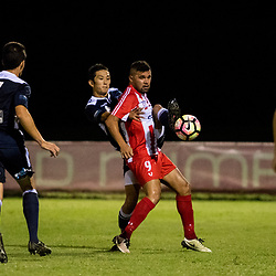 BRISBANE, AUSTRALIA - APRIL 7: Motoki Kakehi of Brisbane City and Ramone Close of Olympic FC compete for the ball during the NPL Queensland Senior Men's Round 7 match between Olympic FC and Brisbane City at Goodwin Park on April 7, 2017 in Brisbane, Australia. (Photo by Patrick Kearney/Olympic FC)