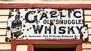Historic whiskey sign at the Cardrona Hotel, Cardrona, Central Otago, South Island, New Zealand