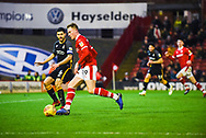 Cauley Woodrow of Barnsley (9) looks to get past Anthony O'Connor of Bradford City (6) during the EFL Sky Bet League 1 match between Barnsley and Bradford City at Oakwell, Barnsley, England on 12 January 2019.