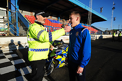 Fife Division, Roads Policing Festive launch, Central Park, Cowdenbeath, 29-11-2019<br /> <br /> Cowdenbeath player Kyle Sneddon gets a drug swipe from PC Seb Milne<br /> <br /> (c) David Wardle | Edinburgh Elite media