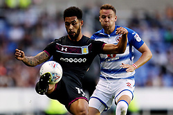 Aston Villa's Andre Green (left) and Reading's Chris Gunter (right) during the Sky Bet Championship match at the Madjeski Stadium, Reading.