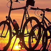 Rockland Color Silhouettes of mountain bikes on a car roof rack at sunset over Blue Hill Overlook. Acadia National Park. Mount Desert Island. Maine