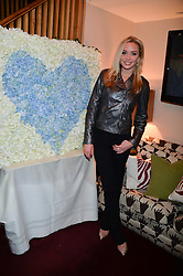 NOELLE RENO at a party hosted by Lady Kinvara Balfour, Lavinia Brennan and Lady Natasha Rufus Isaacs to celebrate the Beulah French Sole Collaboration in aid of the UN Blue Heart Campaign, held at George, 87-88 Mount Street, London on 10th December 2013.