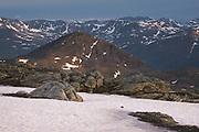 Midnight sun over mountain range