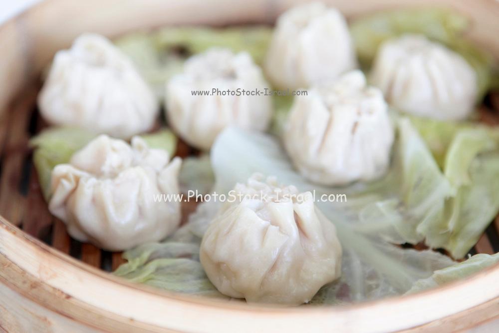Chinese Dumplings in Bamboo Steamer