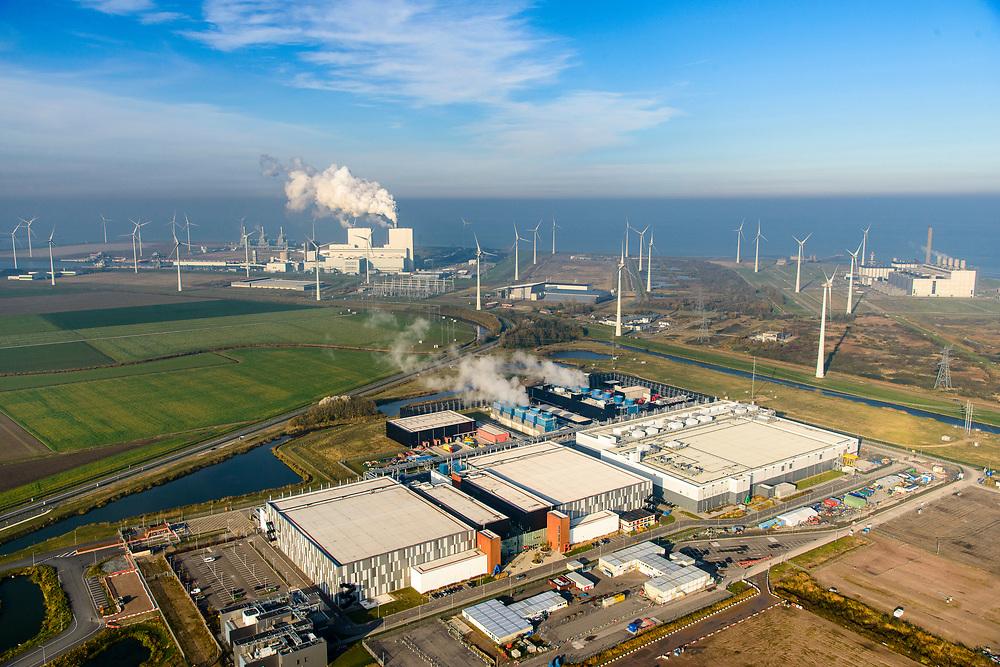 Nederland, Groningen, Eemshaven, 04-11-2018; Google datacentre. De servers hosten onder andere Gmail, Maps en YouTube. Het datacentrum wordt aan de lucht gekoeld, getuige de stoom. In de achtergrond de Eemshaven met de kolengestookte elektriciteitscentrale RWE-Essent.<br /> Google data center in the nearby Eemshaven.<br /> luchtfoto (toeslag op standaard tarieven);<br /> aerial photo (additional fee required);<br /> copyright© foto/photo Siebe Swart