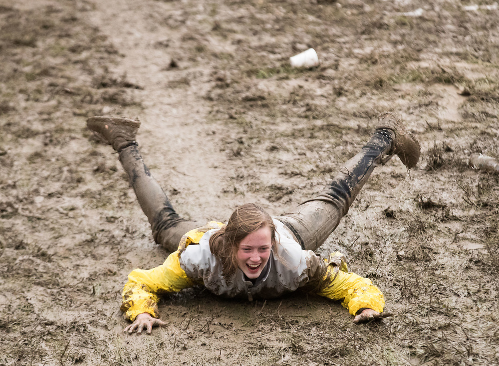 Lincoln Southwest High School freshman Katelyn Thompson slides in the mud during the NSAA state track and field championships at Burke Stadium on Saturday, May 20, 2017, in Omaha.<br /> <br /> MATT DIXON/THE WORLD-HERALD