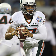 Miami Hurricanes quarterback Stephen Morris (17) drops back during the NCAA Football Russell Athletic Bowl football game between the Louisville Cardinals and the Miami Hurricanes, at the Florida Citrus Bowl on Saturday, December 28, 2013 in Orlando, Florida. Louisville won the game by a score of 36-9. (AP Photo/Alex Menendez)