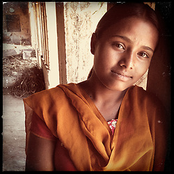 """iPhone portrait of Rajyanti Bairwa, 17, in a village outside of Tonk, Rajasthan, India, April 3, 2013. """"I came to school and told the girls 'I am about to get married' and asked the girls go to my parents and tell them not to let the marriage happen. With their help, I refused the marriage because I want to study and be something. In life I want to be a doctor,"""" said Bairwa.<br /> <br /> Under Indian law, children younger than 18 cannot marry. Yet in a number of India's states, at least half of all girls are married before they turn 18, according to statistics gathered in 2012 by the United Nations Population Fund (UNFPA). However, young girls in the Indian state of Rajasthan—and even a few boys—are getting some help in combatting child marriage. In villages throughout Tonk, Jaipur and Banswara districts, the Center for Unfolding Learning Potential, or CULP, uses its Pehchan Project to reach out to girls, generally between the ages of 9 and 14, who either left school early or never went at all. The education and confidence-building CULP offers have empowered young people to refuse forced marriages in favor of continuing their studies, and the nongovernmental organization has provided them with resources and advocates in their fight."""