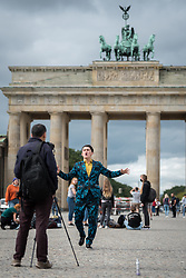 16 September 2021, Berlin, Germany: A man dances while recording a music video at the historical site of Brandenburger Tor in Berlin.