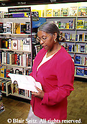 Active Aging Senior Citizens, Retired, Activities, Shopping. Elderly African American Woman in Bookstore, Active Mind, Staying Young