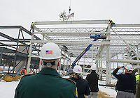 """Capt William Hayes NH State Police, Sgt C.H. McLain Marine Patrol, Ward D'Elia Samyn-D'Elia Architects and Capt Tim Dunleavy of Marine Patrol watch as the final steele beam is set during the traditional """"Topping Off"""" ceremony at the Gilford Marine Patrol Building on Monday morning.  (Karen Bobotas/for the Laconia Daily Sun)"""