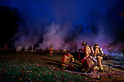Firefighters mop up after a fire destroyed a home in the 7900 block of N. Old Dutch Road, Wednesday, Oct., 30, 2019 in Bloomington, Ind. There were no people injured in the fire, but two cats were missing according to a member of the Ellettsville Fire Department. This story will be updated if more information becomes available.