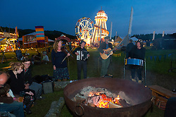 © Licensed to London News Pictures. 30/05/2016. Hay-on-Wye, Powys, Wales, UK. Dusk falls at the Riverside festival site on the fifth day of 'HowTheLightGetsIn' Festival of Ideas - The philosophy and music festival at Hay-on-Wye, Wales, UK. HowTheLightGetsIn festival was founded by post-realist philosopher and director of the Institute of Art and Ideas, Hilary Lawson. Photo credit: Graham M. Lawrence/LNP