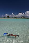 young boy explores lagoon in front of Paris Beach, Christmas Island ( Kiritimati ), Republic of Kiribati, northern Line Islands, equatorial Central Pacific Ocean, MR 300