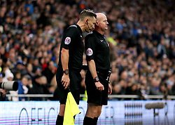 Referee Lee Mason (right) talks to the assistant referee after disallowing a goal scored by Manchester City's Bernado Silva for being offside