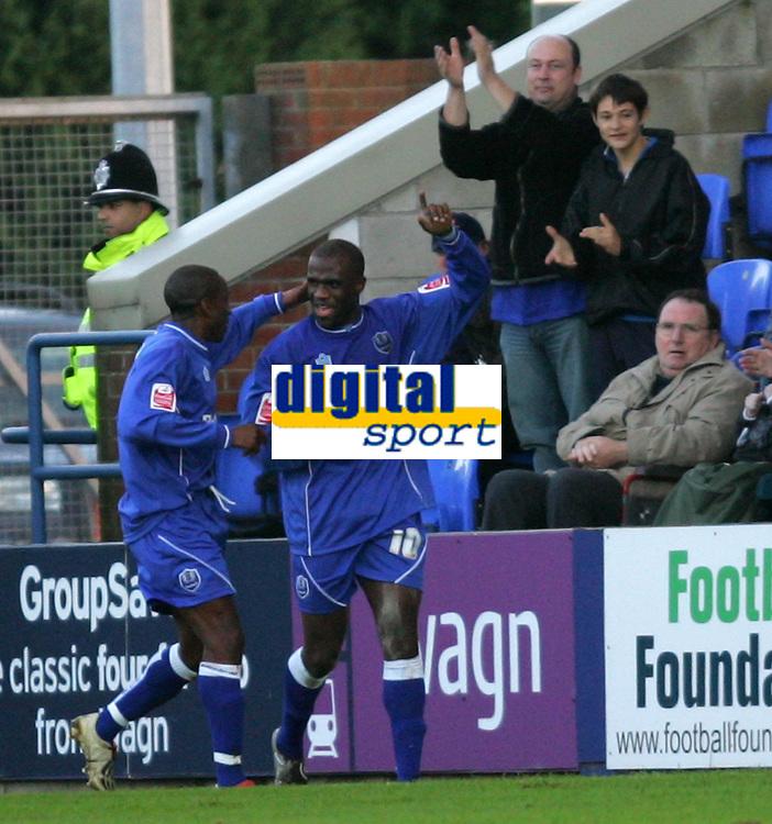 Photo: Frances Leader.<br />Peterborough Utd v Leyton Orient. Coca Cola League 2.<br />12/11/2005.<br />Borough's Calum Willock (R) celebrates his goal against Orient in the first half.
