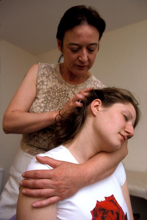 Woman being massaged by female masseuse,