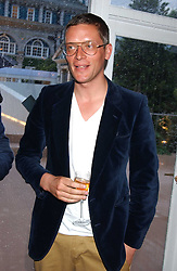 GILES DEACON  at a summer party hosted by champagne house Krug held at Debbenham House, 8 Addison Road, London on 28th June 2005.<br /><br />NON EXCLUSIVE - WORLD RIGHTS