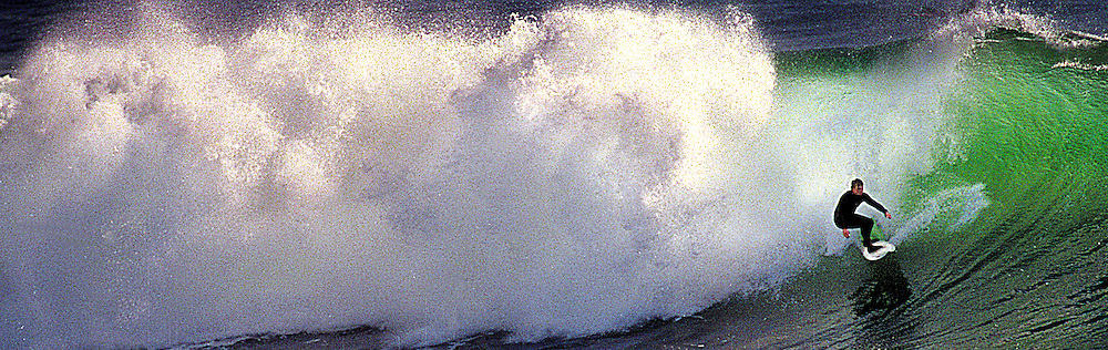 A surfer drops in on a wave during a November swell at Santa cruz' legendary Steamer Lane break.<br /> Photo by Shmuel Thaler <br /> shmuel_thaler@yahoo.com www.shmuelthaler.com