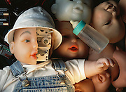 "Robot baby doll. Robot baby doll with part of its ""skin"" removed to show its inner workings. This toy, known as BIT (Baby IT), is a prototype of the My Real Baby interactive baby doll developed by IRobot Corporation and Hasbro Corporation. The BIT doll mimics the facial expression of a human baby by changing the contours on its lifelike rubber face. The BIT baby doll was developed by IS Robotics, Somerville, Massachusetts, USA."