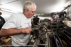 Mike Wild turning the top of a new (to him) cylinder for his 1910 Triumph in Mike Carson's well outfitted rolling shop trailer during the Motorcycle Cannonball Race of the Century. Stage-2 from York, PA to Morgantown, WV. USA. Sunday September 11, 2016. Photography ©2016 Michael Lichter.