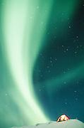 Canada. Yukon Territory. Romantic winter camping with Aurora Borealis.