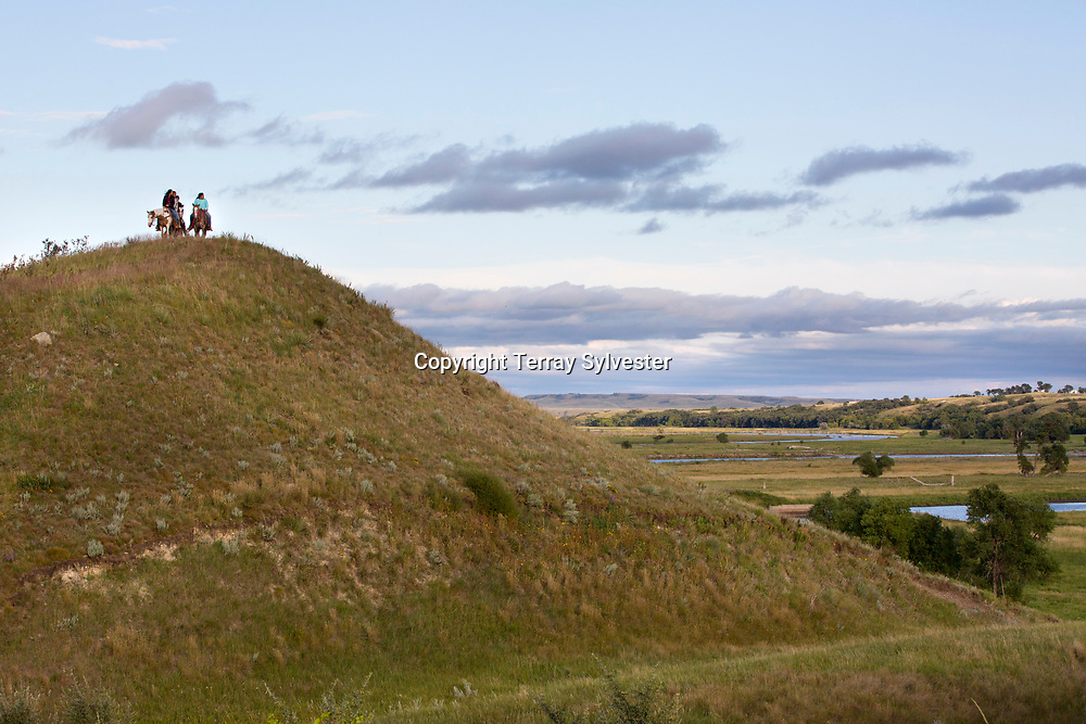 Riders stand on a hill above the confluence of the Cannonball and Missouri rivers, near the route of the Dakota Access oil pipeline, on August 27, 2016. North Dakota, United States.