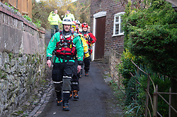 © Licensed to London News Pictures. 26/02/2020. Ironbridge, UK. Emergency personal walk towards a high volume pump in need of refuelling as flood defences are under threat of collapse in Ironbridge on part of the River Severn, police evacuated part of the town when the flood barriers moved approximately three feet under the strain of the rising water levels. Photo credit: Peter Manning/LNP