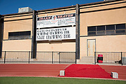 A sign marking the accomplishments of the Iraan High School football team hangs near the football stadium in Iraan, Texas on December 13, 2016. (Cooper Neill for The New York Times)