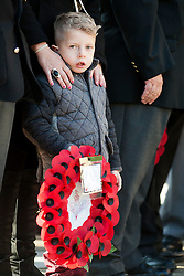 A young boy waits to lay a wreath of poppies at the War memorial outside Barnsley Town Hall as  Barnsley Marks the Centenary of the out break of World War I on Remembrance Sunday <br /> <br /> 09 November 2014<br /> <br /> Image © Paul David Drabble <br /> <br /> www.pauldaviddrabble.co.uk