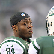 Stephen Hill, (left), New York Jets, talking with quarterback Matt Simms during the New York Jets Vs Miami Dolphins  NFL American Football game at MetLife Stadium, East Rutherford, NJ, USA. 1st December 2013. Photo Tim Clayton