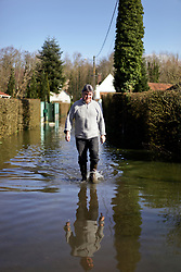 12 March 2020. Beaumerie St Martin, Pas de Calais, France.<br /> Monsieur Patrice Sibilli wades through floods to help his brother in law in a nearby flooded home. Following months of record rainfalls, the Canche River near Montreuil Sur Mer burst its banks flooding local homes. The river last flooded in 2013, however residents claim they have never seen it as bad as this.<br /> Photo©; Charlie Varley/varleypix.com