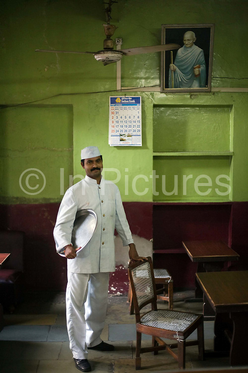Mr Sri Kumar, a waiter in the Indian Coffee House. Originally from Kerala, Mr Kumar has worked at the Coffee House for 8 years. Jaipur, India